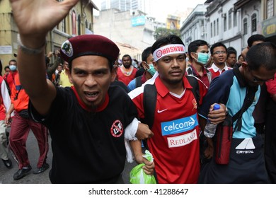 KUALA LUMPUR - AUGUST 1: Participants of the anti-ISA (Internal Security Act) protest marching on road in August 1, 2009, in Kuala Lumpur, Malaysia.