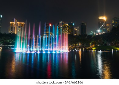 KUALA LUMPUR - AUGUST 2019 : Lake Symphony Water Fountain Show at the esplanade outside of Suria KLCC during night time.