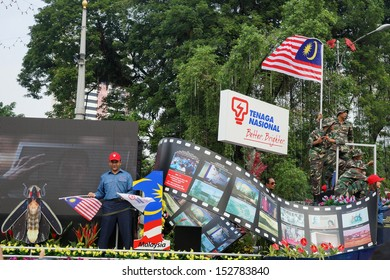 KUALA LUMPUR - AUGUST 31: Malaysians from all walks of life take to the city streets celebrating Malaysia's Independence Day (Hari Kemerdekaan) on August 31, 2013 in Kuala Lumpur, Malaysia.