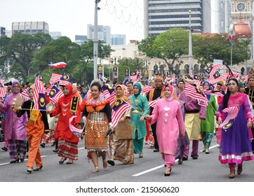 KUALA LUMPUR - AUGUST 31: Multi ethnic with traditional wear during 57th Celebrations, Malaysian Independence Day Parade on August 31, 2014 in Kuala Lumpur, Malaysia.