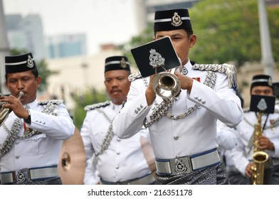 KUALA LUMPUR - AUGUST 31: Participants of musical band from police department during 57th Celebrations, Malaysian Independence Day Parade on August 31, 2014 in Kuala Lumpur, Malaysia.