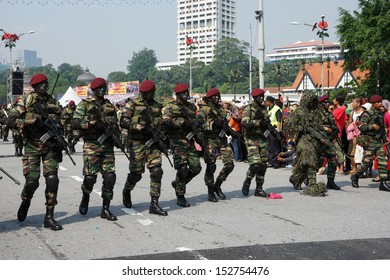 KUALA LUMPUR - AUGUST 31: Snipers and Recce scouts from the 10th Airborne Brigade march on the city streets as celebrating Malaysia's Independence Day on August 31, 2013 in Kuala Lumpur, Malaysia.