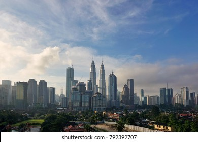 Kuala Lumpur City in the morning, looks foggy clouds with blue sky background