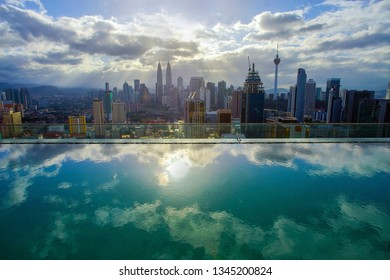 Kuala Lumpur city skyline with dramatic ray of light and cloud formation