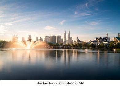 Kuala Lumpur city skyscraper and fountation with nice sky morning at Titiwangsa Park in Kuala Lumpur. Malaysia. Travel and Vacation concept.