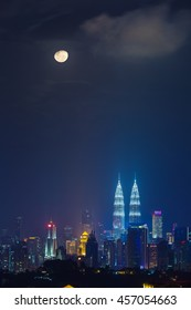 Kuala Lumpur cityscape in a moon lit night, vertical