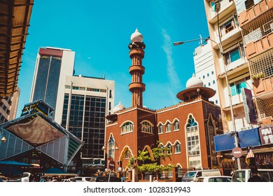 Kuala Lumpur cityscape. Religious and modern architecture. Travel to Malaysia. Mosque Masjid India. City tour. Street market area. Tourism industry. Building facade. Urban background. Street scene