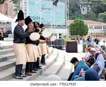 KUALA LUMPUR - DEC 3, 2017: Malay traditional Kompang performers at the Expo Negaraku 2017 in Dataran Merdeka, KL. The Expo showcased Malaysian infrastructure achievement.