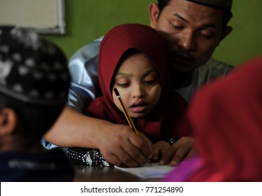 KUALA LUMPUR - December 16th 2016: Children of Rohingya refugees learning to write during class session. Thousands of Rohingya refugee fled to Malaysia dued to ethnic criss in Myanmar.