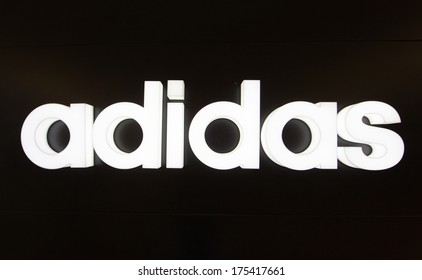 KUALA LUMPUR - DECEMBER 23: Adidas Logo at KLCC on Dec 23, 2013 in KL, Malaysia. It is a German multinational corporation that designs and manufactures sports clothing and accessories.