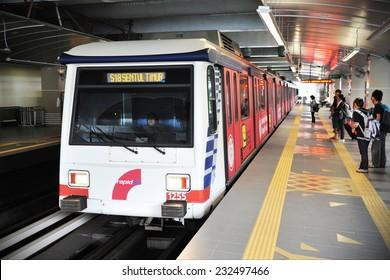 KUALA LUMPUR - FEB 15: A RapidKL LRT train departs a city centre station on Feb 15, 2012 in Kuala Lumpur, Malaysia. The Malay capital's RapidKL transport network serves 690,000 passengers daily.