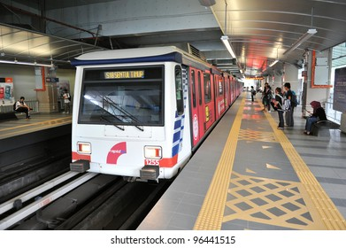 KUALA LUMPUR - FEB 15: A RapidKL LRT train departs Plaza Rakyat station on Feb 15, 2012 in Kuala Lumpur, Malaysia. RapidKL's transport network serves approximately 690,000 passengers daily.