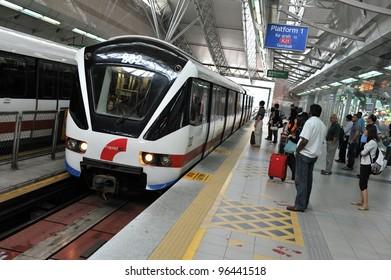 KUALA LUMPUR - FEB 15: A RapidKL LRT train pulls into Sentral station on Feb 15, 2012 in Kuala Lumpur, Malaysia. RapidKL's transport network serves approximately 690,000 passengers daily.
