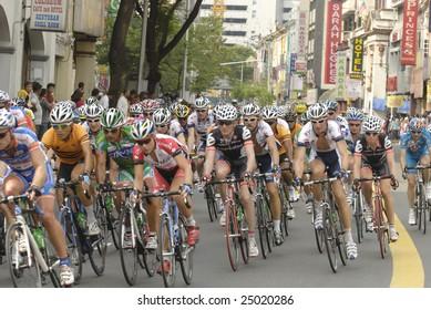 KUALA LUMPUR - FEBRUARY 15 : Cyclists participate in the Le Tour de Langkawi cycling race on February 15, 2009 in Kuala Lumpur, Malaysia.