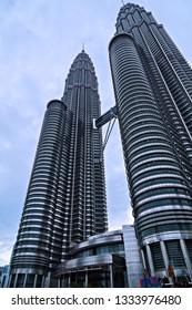 KUALA LUMPUR - February 19, 2015: The Petronas Twin Towers world's tallest twin tower. The Menara Berkembar Petronas Commercial offices and tourist attraction skyscraper 88-floor in Kuala Lumpur.
