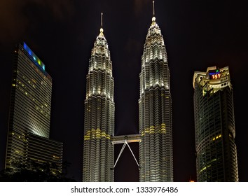 KUALA LUMPUR - February 19, 2015: The Petronas Twin Towers world's tallest twin tower. The Petronas Commercial offices and tourist attraction skyscraper 88-floor, at night.