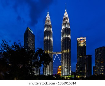 KUALA LUMPUR - February 19, 2015: The Petronas Twin Towers world's tallest twin tower. The Petronas Commercial offices and tourist attraction skyscraper 88-floor, colorful musical fountain at night.