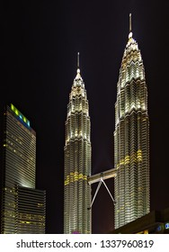 KUALA LUMPUR - February 19, 2015: The Petronas Twin Towers world's tallest twin tower. The Petronas Commercial offices and tourist attraction skyscraper 88-floo at night.