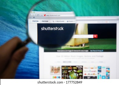 KUALA LUMPUR - FEBRUARY 20, 2014: Shutterstock's homepage through magnifying glass. Shutterstock was founded in 2003 and headquartered in New York City.