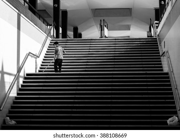 Kuala Lumpur, February 2016 - A black and white photo showing an unidentified cleaner seen cleaning the steps of a building in Kuala Lumpur Malaysia.