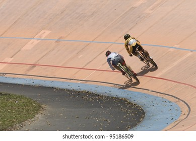 KUALA LUMPUR - FEBRUARY 9: Rider from Malaysia (right) competed with rider from Japan (left) during Asian Cycling Championships 2012 held in Kuala Lumpur, Malaysia on February 9, 2012.