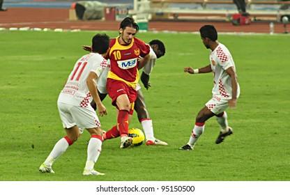 KUALA LUMPUR - FEBRUARY 14:Boško Balaban(10) Selangor striker in action during 2012 Super League between Selangor and Kelantan(White) on Feb 14, 2012  in Kuala Lumpur. Selangor won 2-1.