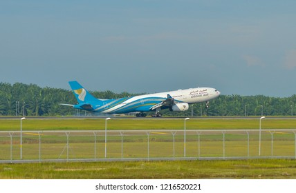 KUALA LUMPUR INTERNATIONAL AIRPORT (KLIA), MALAYSIA - October 20, 2018; Oman Airways landing at Kuala Lumpur International Airport.