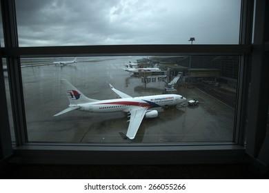 KUALA LUMPUR INTERNATIONAL AIRPORT (KLIA), SEPANG, MALAYSIA - AUGUST 08 :Malaysia Airlines plane on a wet tarmac at Kuala Lumpur International Airport (KLIA) in Sepang, Malaysia.