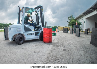 Kuala Lumpur International Airport, Malaysia 17 March 2017; A group of workers here do Forklift driving test to get certified license to enable them doing any work legally.
