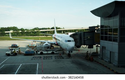 KUALA LUMPUR INTERNATIONAL AIRPORT - November 1, 2015: A Malaysia Airlines plane prepares for passengers to board, as ground crew prepares the plane for the next flight, in KLIA, Malaysia.