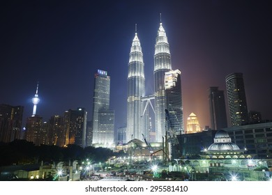 KUALA LUMPUR - JULY 11: The Petronas Towers at night on July 11, 2015 in Kuala Lumpur, . Petronas are the tallest twin buildings in the world (451.9 m)