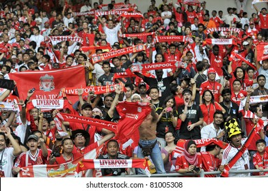 KUALA LUMPUR - JULY 14 : Liverpool football club fans cheer their players during warm up session on July 14, 2011 in Kuala Lumpur, Malaysia. Liverpool FC will meet Malaysian XI soccer team on July 16.