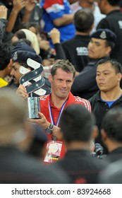 KUALA LUMPUR - JULY 16: Liverpool player Jamie Carragher with the winner's trophy after a friendly match against Malaysia on July 16, 2011 in Kuala Lumpur, Malaysia. Liverpool won 6-3.