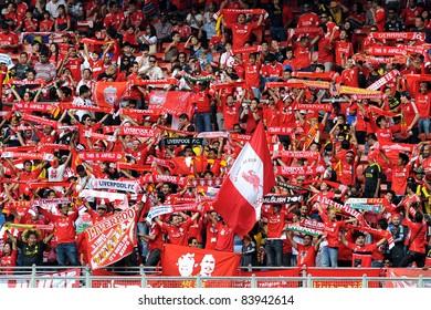 KUALA LUMPUR - JULY 16: Liverpool football club fans sing 'You'll never walk alone' during a friendly match against Malaysia XI on July 16, 2011 in Kuala Lumpur, Malaysia. Liverpool won 6-3.