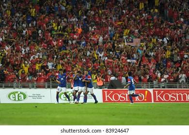 KUALA LUMPUR - JULY 16: Malaysian goal celebration during a friendly match against Malaysia on July 16, 2011 in Kuala Lumpur, Malaysia. Liverpool won 6-3.