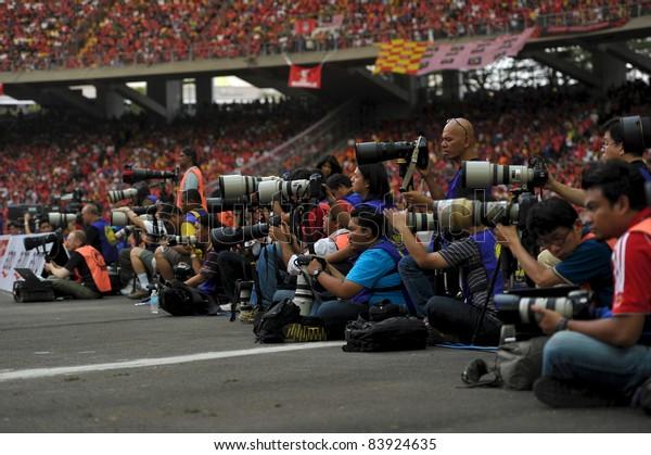 KUALA LUMPUR - JULY 16: Photographers at work during a friendly match against Malaysia on July 16, 2011 in Kuala Lumpur, Malaysia. Liverpool won 6-3.