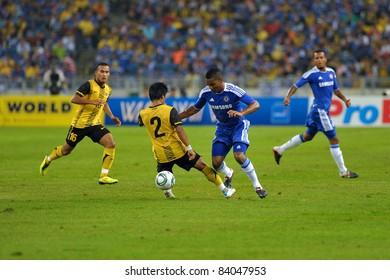 KUALA LUMPUR, July 21 : Chelsea's Florent Malouda (center blue) and Malaysian Daudsu Jamaluddin (2) in action during a preseason match agains Malaysia on July 21, 2011 in Kuala Lumpur, Malaysia.