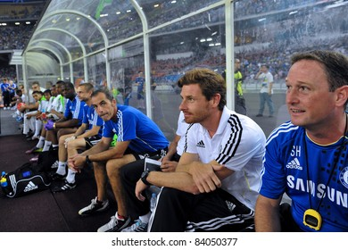 KUALA LUMPUR, JULY 21 : Chelsea's manager Andre Villas-Boas (white shirt) sitting on bench during a preseason match against Malaysia on July 21, 2011 in Kuala Lumpur, Malaysia. Chelsea won 1-0