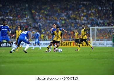 KUALA LUMPUR, July 21 : Malaysian Thamil Arasu (center yellow-14) in action during a preseason match agains Malaysia on July 21, 2011 in Kuala Lumpur, Malaysia. Chelsea won 1-0