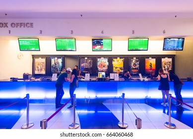 KUALA LUMPUR - JUNE 16, 2017: Unidentified people buy tickets at the box office of Golden Screen Cinemas located in Pavilion mall situated in the Bukit Bintang district.