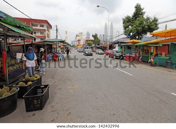 KUALA LUMPUR - JUNE 16: Street vendor at her street stall on June 16, 2013 in Kampung Baru, Kuala Lumpur. The area is a gazetted Malay enclave to retain village lifestyle within the city.