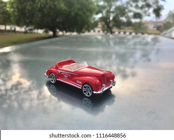 "KUALA LUMPUR - JUNE 19 : Classic red Austin Healey Mk1 ""Frogeye"" Sprite from 1960's toy car at nature background show on June 19, 2018 at Kuala Lumpur, Malaysia."