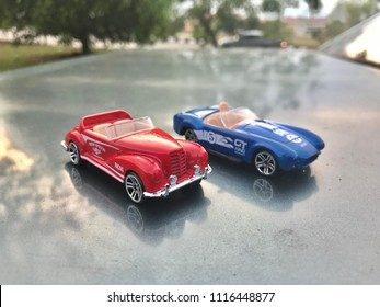 """KUALA LUMPUR - JUNE 19 : Classic red Austin Healey Mk1 """"Frogeye"""" Sprite from 1960's toy car at nature background show on June 19, 2018 at Kuala Lumpur, Malaysia."""