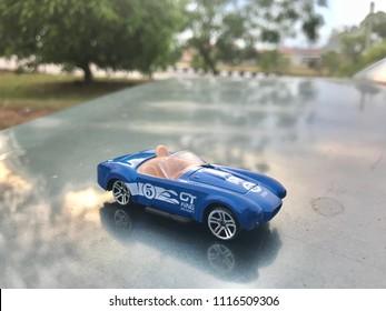 KUALA LUMPUR - JUNE 19 : Classic blue Austin Martin James bond 007 from 1960's toy car at nature background show on June 19, 2018 at Kuala Lumpur, Malaysia.