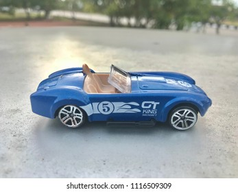 KUALA LUMPUR - JUNE 19 : Classic blue Austin Martin James bond 007 from 1960's toy car at nature background show on June 19, 2018 at Kuala Lumpur, Malaysia.
