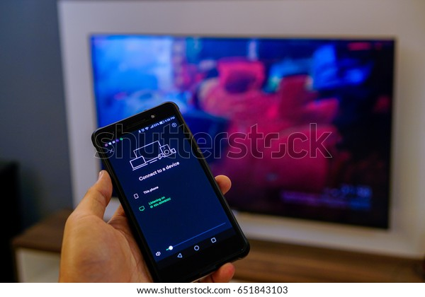 Kuala Lumpur - June 2nd 2017 : Home User are casting music on SPOTIFY from their smartphone via Google CHROMECAST with no remote used. CHROMECAST is a line of digital media players developed by Google