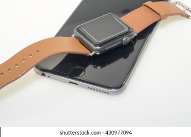 Kuala Lumpur, Malasysia - June, 2016:A close-up of  Apple iPhone and Apple watch on  Isolated white background..