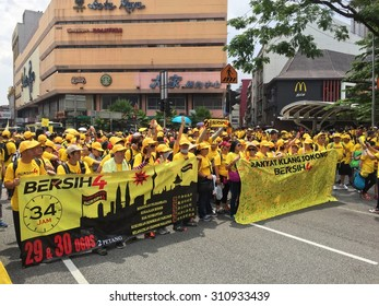 Kuala Lumpur, Malayia 29 August 2015 : Yellow shirt Supporters display banner and signature campaign Bersih Rally for Free Fair Elections. Bersih organized Rallies 29/30 Aug in cities around Malaysia
