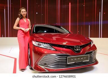 Kuala Lumpur, Malayisa - November 22.2018 :   A model with New Toyota Camry at Kuala Lumpur International Motor