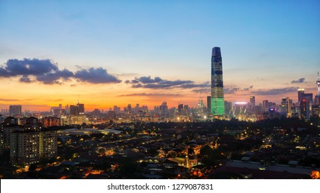 Kuala Lumpur, Malaysia - 08 January 2019: Dramatic sunset over Kuala Lumpur skyline with new landmark TRX Tower dominating the photo. Visible grains due to long exposure.